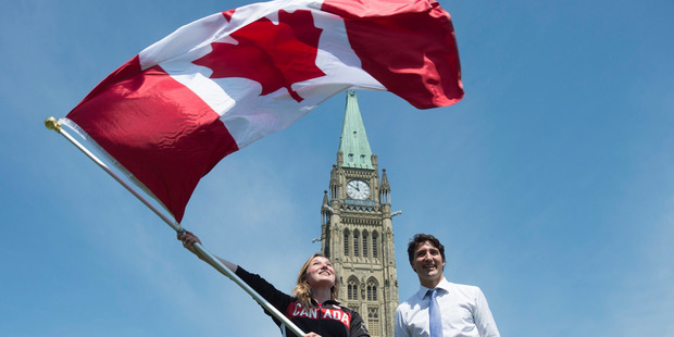 If we joined with the UK, Canada and Australia, Justin Trudeau, above (with Summer Olympian Rosie MacLennan), could be our hot PM, too. Photo / AP