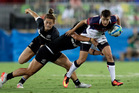 Olympic action: US' Jessica Javelet (right) is tackled by New Zealand's Portia Woodman during the women's rugby sevens quarter final. Photo / AP