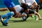 New Zealand's Portia Woodman, front, scores a try as Fiji's Lavenia Tinai, top, defends during the women's rugby sevens match at the Summer Olympics in Rio. Photo / AP.