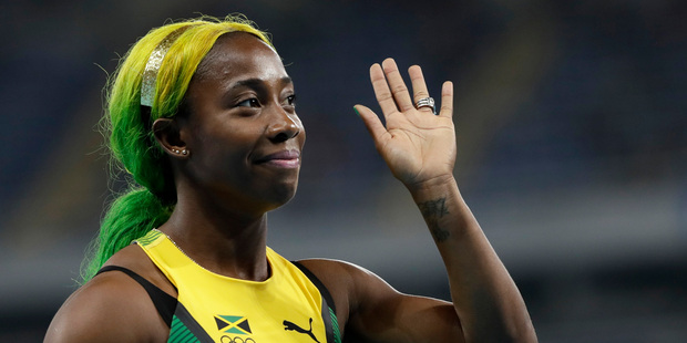 Jamaica's Shelly-Ann Fraser-Pryce sported a colourful new hairdo as she became the only woman to break 11 seconds in the women's 100-metre heats in Rio. Photo / AP