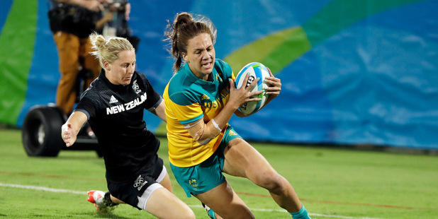 Australia's Evania Pelite, right, scores a try as New Zealand's Kelly Brazier, chases during the women's rugby sevens gold medal match against New Zealand at the Summer Olympics in Rio de Janeiro.