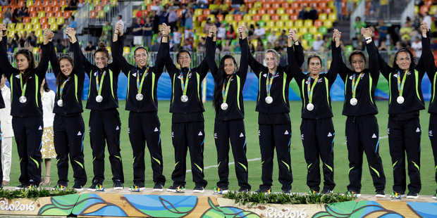 The members of the women's sevens side who claimed silver will collectively be able to put their hands up for $660,000. Photo / AP