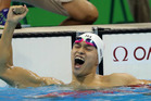Aussies have mocked Sun Yang's teeth after the Chinese swimmer won today's men's 200m freestyle. Photo / AP