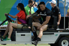 New Zealand's Sonny Bill Williams is driven out of the stadium by medics. Photo / AP