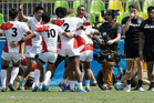Japan's players celebrate after winning the men's sevens match against New Zealand. Photo / AP