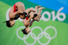 Roseline Filion and Meaghan Benfeito compete during the women's synchronized diving final at the Olympics in Rio de Janeiro. Photo / AP
