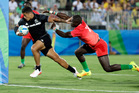 New Zealand's Augustine Pulu, left, avoids a tackle Kenya's Bush Mwale, to score a try during the men's rugby sevens match at the Summer Olympics in Rio. (AP Photo/Themba Hadebe)