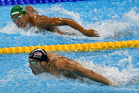 South Africa's Chad Le Clos, top, looks to United States' gold medal winner Michael Phelps. Photo / AP