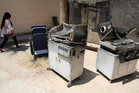 Burned incubators for newborn babies are dumped outside a maternity ward after a fire at Yarmouk hospital in western Baghdad, Iraq. Photo / AP