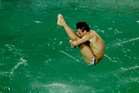 Brit Tom Daley takes part in a training session after the water in the diving pool turned green. Photo / AP
