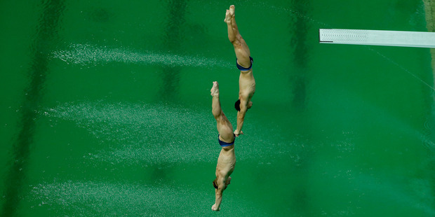 Britain's Jack Laugher and Chris Mears compete during the men's synchronized 3-meter springboard diving final. Photo / AP