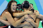 The victorious United States relay team celebrate with Katie Ledecky, second from right. Photo / AP