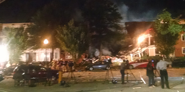 Loading The explosion at the Maryland apartment complex, sent a door across the street, left clothes in trees and shoes strewn across a road. Photo / AP
