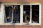 Emergency personnel investigate the inside of the apartment building following the fire in Silver Spring. Photo / AP