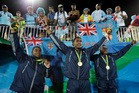Vatemo Ravouvou, Viliame Mata, and Semi Kunatani, of Fiji, pose with fans after winning the gold medal match against Britain. Photo / AP.