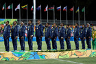 Fiji rugby players stand during the playing of their national anthem after winning the gold medal match against Britain in the mens rugby sevens. Photo / AP