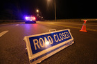 Police close State Highway One south of Whangarei after a serious crash between a truck and trailer and 4WD. Photo / File