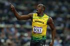 Usain Bolt of Jamaica celebrates after he wins the gold in the final of the 200m, held at Olympic Stadium, Stratford, London. Photo / Brett Phibbs