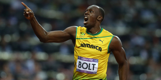 Usain Bolt celebrates after winning gold in the final of the 200 metres at the 2012 London Olympics. Photo / New Zealand Herald