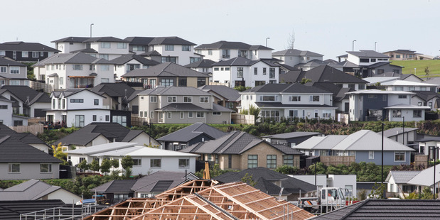 Migrants are having a relatively small impact on Auckland's rising house prices, a new study says. Photo / Greg Bowker