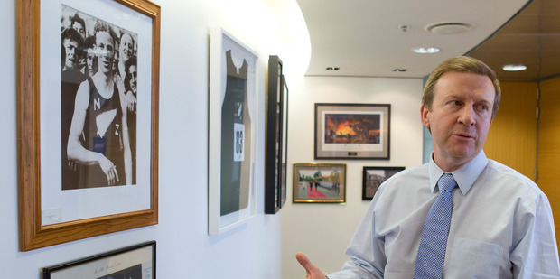 Sport Minister Jonathan Coleman in his Beehive office beside a photo of New Zealand's 1500m 1936 Olympic gold medallist Jack Lovelock. PHOTO/Mark Mitchell