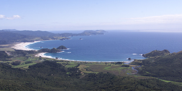 An aerial view of Medlands Beach (right) and Kaitoke Beach (upper left) on Great Barrier Island. Photo / Kenny Rodger