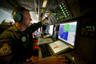 Royal Air Force Weapons Systems Officer, Flight Lieutenant Eric Kingduring the search mission of the Southern Indian Ocean for Malaysia Airlines MH370. Photo / AP