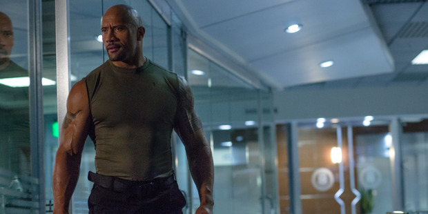"""Dwayne 'The Rock' Johnson has called out his """"candy-ass"""" male castmates on Facebook. Photo / Supplied"""