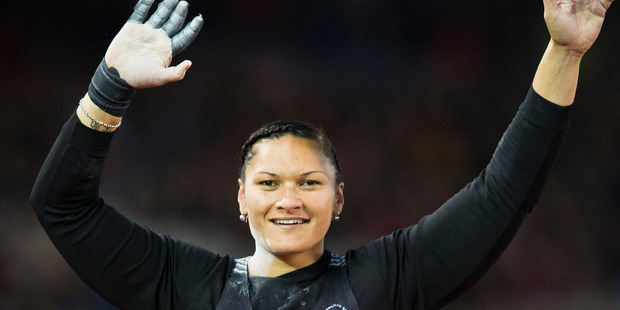 Valerie Adams celebrates after winning gold in the women's shot during the XX Commonwealth Games in Glasgow. Photo / Greg Bowker