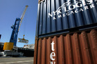 Containers being loaded at the Port of Napier. Exporters are hoping for a fall in the exchange rate. Photo / NZME.