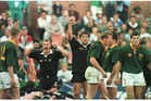 Justin Marshall and Zinzan Brooke celebrate as the All Blacks win 33 - 26 over the Springboks at Pretoria. Photo / Paul Estcourt