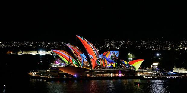 Sydney Opera House sails light up as part of Vivid Sydney. Photo / Getty Images