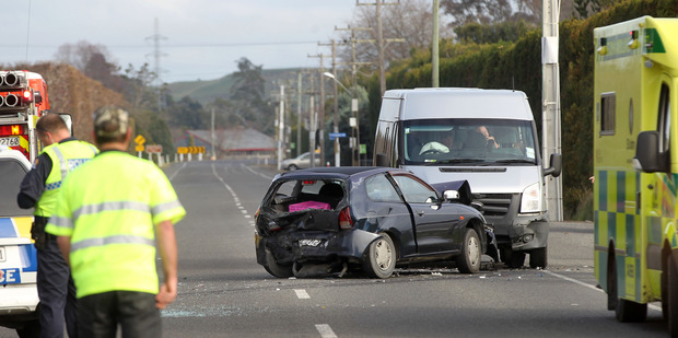 CRASH: Three people are injured following a three-car crash on Links Rd, Napier. Photo/Duncan Brown.