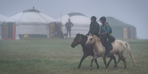 Krista Donnelly and a riding companion set off at 7am in misty conditions in Mongolia. Photo / Richard Dunwoody