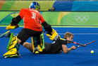 GOAL: Shay Neal beats Brazilian goalkeeper Rodrigo Faustino to score during their 9-0 rout in the men's hockey competition at the Rio Olympics. Photo/Photosport.nz