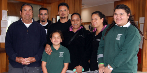 Alexander Campbell-Lewis with members of his family before his first hair cut - from the left grandfather Cedric Campbell, uncle Sonny, dad Rangi Lewis, mum Pippa Campbell, aunty Jojo and cousin Mateja, above.