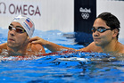 United States' Michael Phelps and Singapore's Joseph Schooling check their times after a men's 100-meter butterfly heat during the 2016 Summer Olympics. Photo / AP