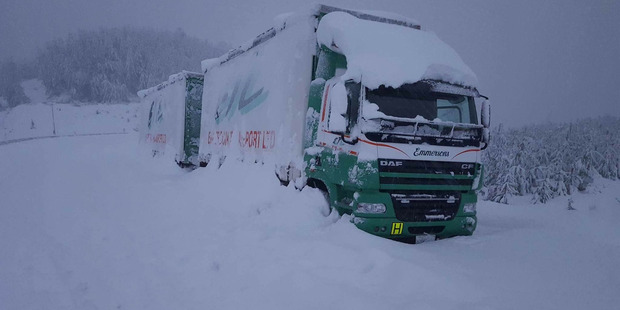 STUCK: The Emmerson truck covered in snow. PHOTO/SUPPLIED