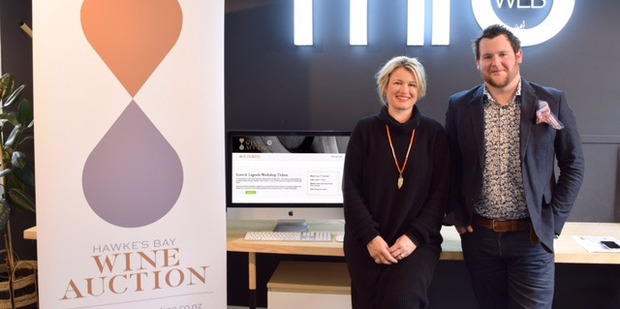Auction organiser Annabel Tapley-Smith and MRD web developer Mike Reaney stand by their newly established ticketing system made for the event.