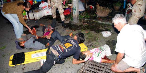 Injured people are helped after a bomb blast in the southern resort city of Hua Hin. Photo / AP