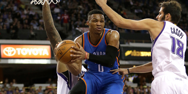 Oklahoma City Thunder guard Russell Westbrook looks to pass against Sacramento. Photo / AP