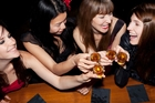 Young women are skipping meals to drink. Photo / Getty Images