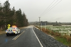 Police monitor the deep flooding which closed State Highway 16.