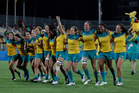 Australia's players celebrate after winning the women's rugby sevens gold medal. Photo / AP