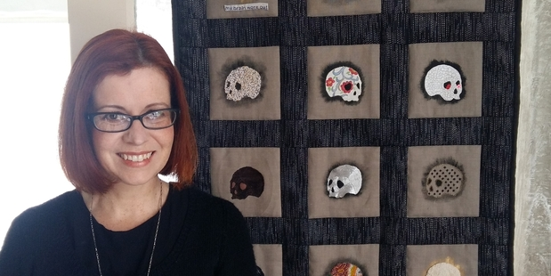 ART IS NOT DEAD, BUT DEATH CAN BE ART: Maree Burnnand takes embroidery to a new level. She is pictured here standing by a piece created as a group project.