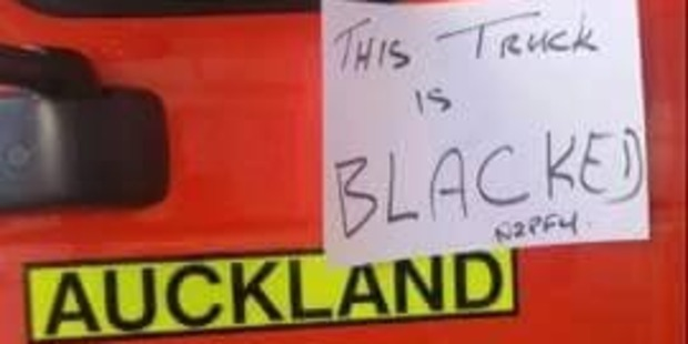 The note on the 'blacked' fire truck. Photo / Supplied