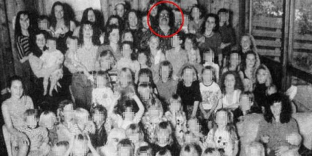 The cult leader, circled, was also convicted of throwing a plank of wood at the head of one of the children. Photo / AP