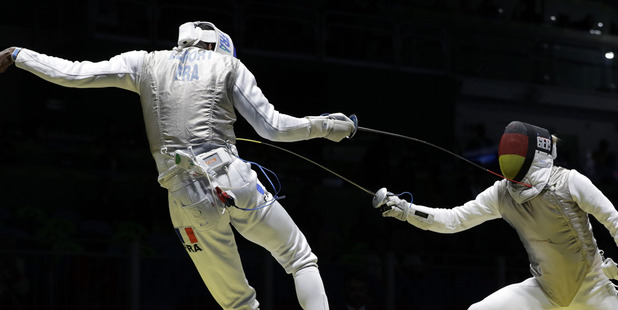 Peter Joppich of Germany competes with of Enzo Lefort France in the men's individual foil fencing event. photo / AP