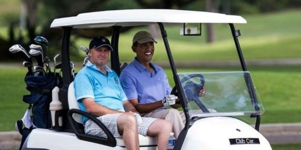 Barack Obama and John Key drive up to the green of the second hole at the Kaneohe Klipper Golf Course. Photo / AFP