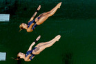 The Olympic diving pool has turned green overnight with an algae breakout thought to be the reason. Photo / AP